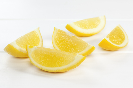 Lemon Wedges on White Background - lemon wedges or slices on a white background with soft shadows.