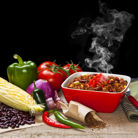 Chilli and Ingredients with Steam Rising Stock Photo