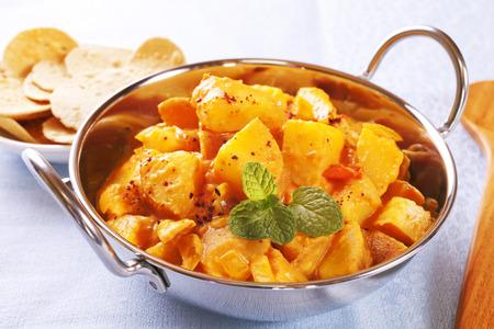 Bombay Potato Curry Stock Photo - 115317037