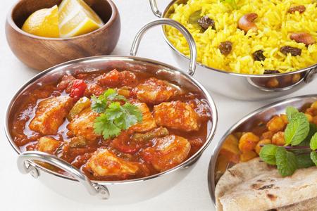 Chicken Jalfrezi Curry and Yellow Rice Pillau Stock Photo