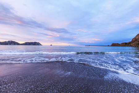 Dawn, Tolaga Bay, New Zealand 免版税图像 - 116961834
