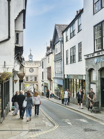 Shopping in Totnes High Street Devon UK