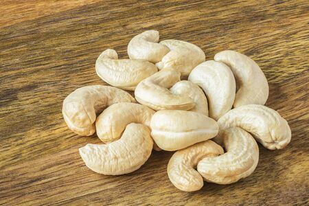 Cashew Nuts, Front to Back Focus Stack, A Handful on a Mango Wood Board Archivio Fotografico - 134361573