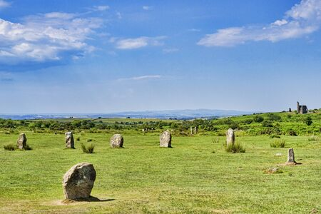 The Hurlers stone circle, one of a group of three on Bodmin Moor near Minions, Cornwall, UK. Remains of the Cornish tin and copper mining industry can be seen. 免版税图像