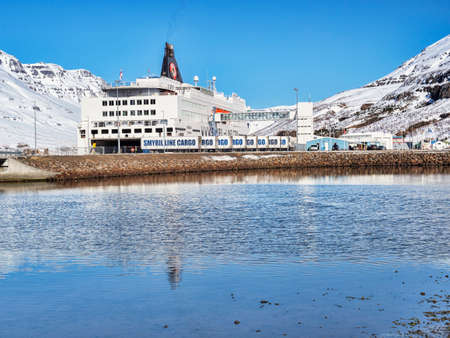 11 April 2018: Seydisfjordur, East Iceland - Smyril Line ferry MS Norrona in port on a bright spring day. 新闻类图片
