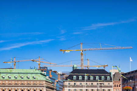 Stockholm Sweden, Cranes Working above Rooftops