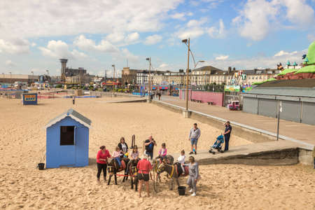 Children Riding Donkeys, Great Yarmouth, UK
