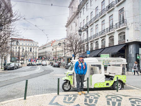 Tuk Tuk Driver Waiting for Business Central Lisbon