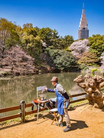 Painting in Shinjuku Gyoen National Garden, Tokyo 免版税图像 - 156056049