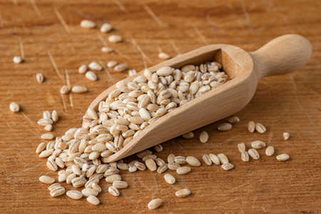 Pearl Barley in a Scoop on a Wooden Board