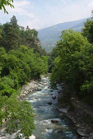 Merano, Italy: The Passer River and surrounding countryside 版權商用圖片 - 127787573