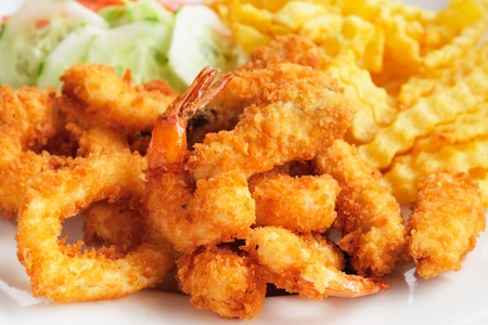 deep fried: Seafood plate with shrimps, calamari, cucumber, french fries Stock Photo