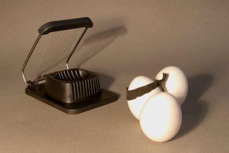 Egg being led to slicer   Stock fotó