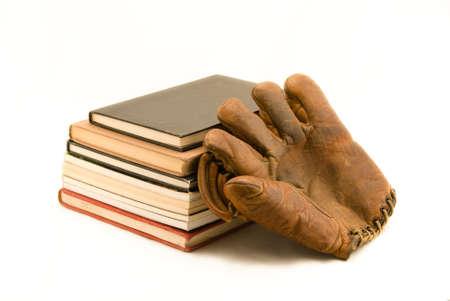 mitt: Stack of book and old baseball mitt