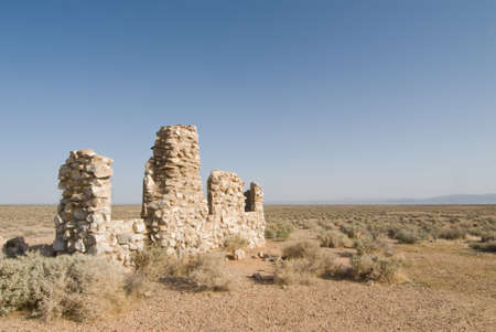 Rock structure ruins with sweeping vista in mojave desert California.