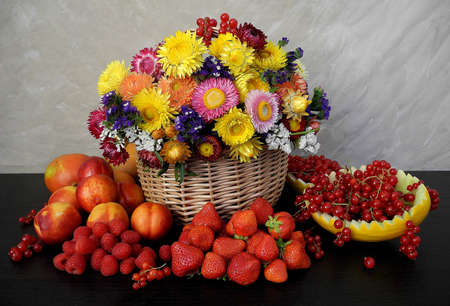 willow fruit basket: Flowers and Fruit Still Life Stock Photo
