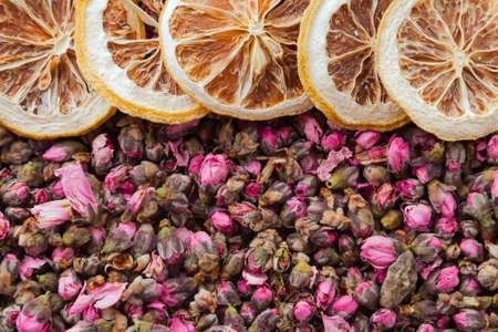 Tea flowers texture. Peach blossom tea with lemon. Organic dried flower tea leaves