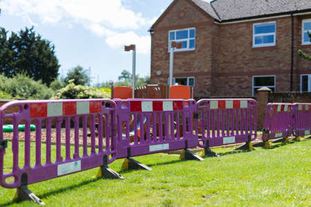A child's play park that has been fenced off due to construction and improvement work needed to make it safe