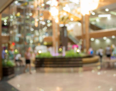go inside: Shopping mall blurred background Stock Photo