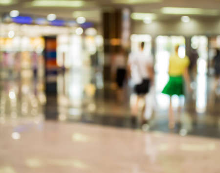 large store: Blurred Background: man and woman are by and large store