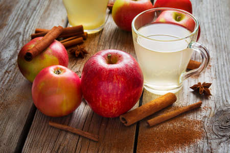 cider: Apples, cider and cinnamon on old wooden table