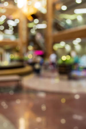croud: Blurred background: interior of shopping-mall gallery, shop-wind