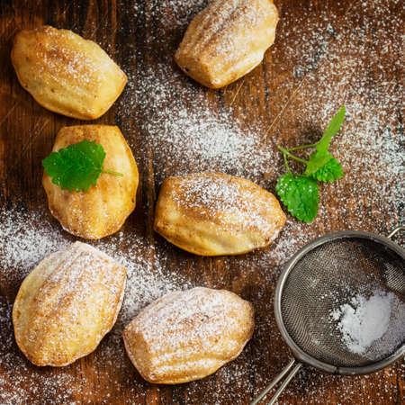 madeleine: Madeleine biscuits on a vintage background