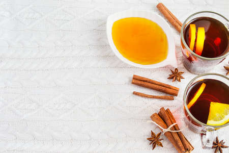gripe: Black tea with lemon, cinnamon and honey. Cozy winter background