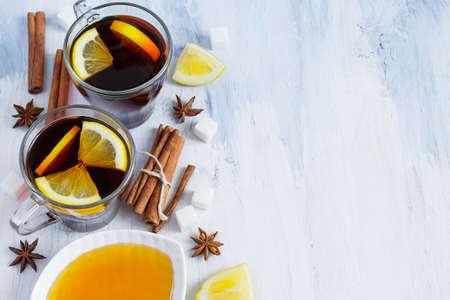 slushy: Black tea with lemon, cinnamon and honey on white wooden backgrond