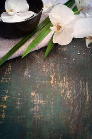 Spa background with white orchid. Space for text.