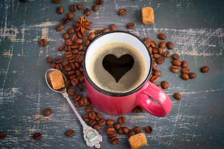 crema: Espresso mug with a heart of crema on vintage background. Stock Photo
