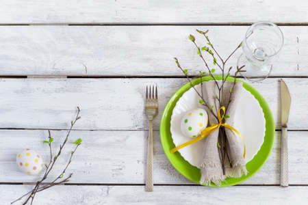 serving utensil: Spring Easter Table setting at wooden table. Stock Photo