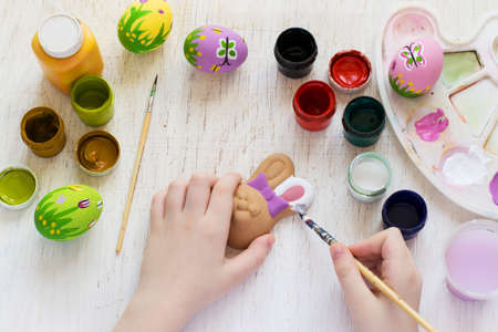 pink and green: Childrens hand painted Easter bunny and eggs.