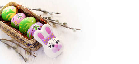 pink and green: Easter background with colored eggs and rabbit. The top view, space for text