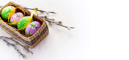 butterfly rabbit: Easter background with painted eggs and pussy willow.  top view, space for text Stock Photo