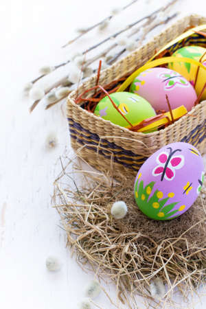pink and green: Painted Easter eggs with spring patterns on a white background, handmade.