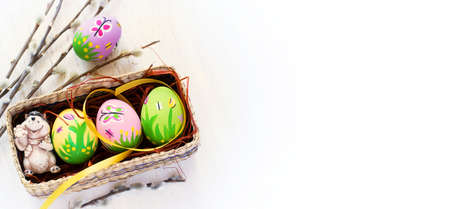 butterfly rabbit: Easter background with colored eggs, handmade, top view, space for text
