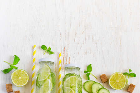 infusing: Lime, cucumber, parsley lemonade in bottles on a white background. Space for text Stock Photo