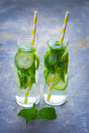 infusing: Lime, cucumber lemonade in bottles with straws.