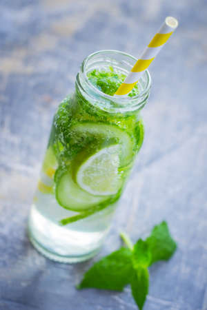infusing: Mint and cucumber detox drink, selective focus.