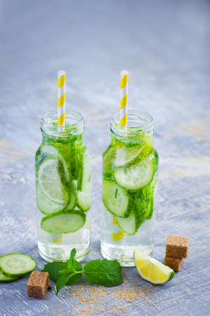 infusing: Cucumber and lime lemonade in bottles, detox water