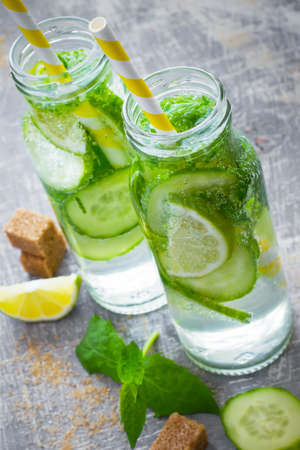 infusing: Lime cocktail with bottles lemonade detox water. Stock Photo