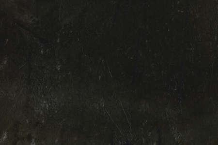 heterogeneous: Heterogeneous dark background with traces of spatula. Stock Photo