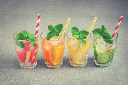 infusing: Refreshing summer drinks, iced water and fruit. detox water. tinted Stock Photo