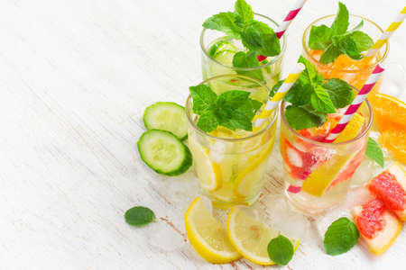 infusing: Summer drinks water with ice, mint and citrus, copy space. Stock Photo