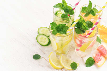 infusing: Summer drinks water with ice, mint, cucumber and citrus, copy space, tinted