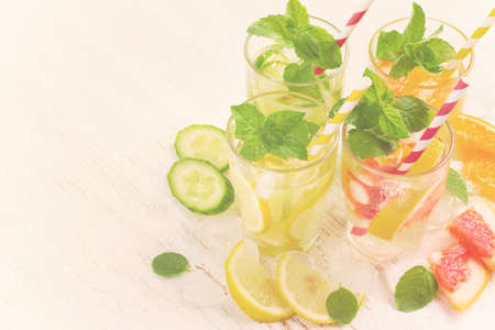 infusing: Summer drinks water with ice, mint and citrus, copy space, tinted
