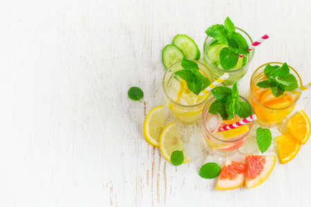 infusing: Summer drinks water with ice, mint and citrus, copy space