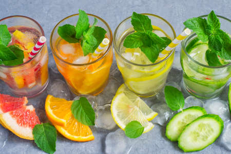 infusing: Refreshing Detox summer drinks water with ice and citrus and cucumber