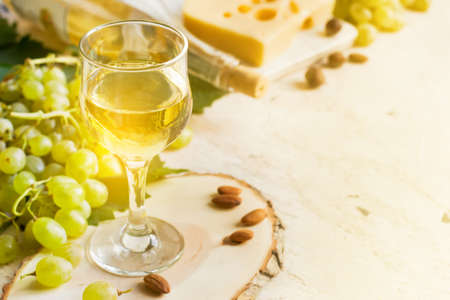 White wine in a glass on a white background, tinted, copy space. Stock Photo
